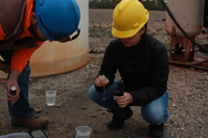 Students from Kansas State University sample water from natural gas production wells in the Cherokee basin of southern Kansas as part of a study to understand the role of microorganisms in the generation of natural gas from organic matter in the subsurface