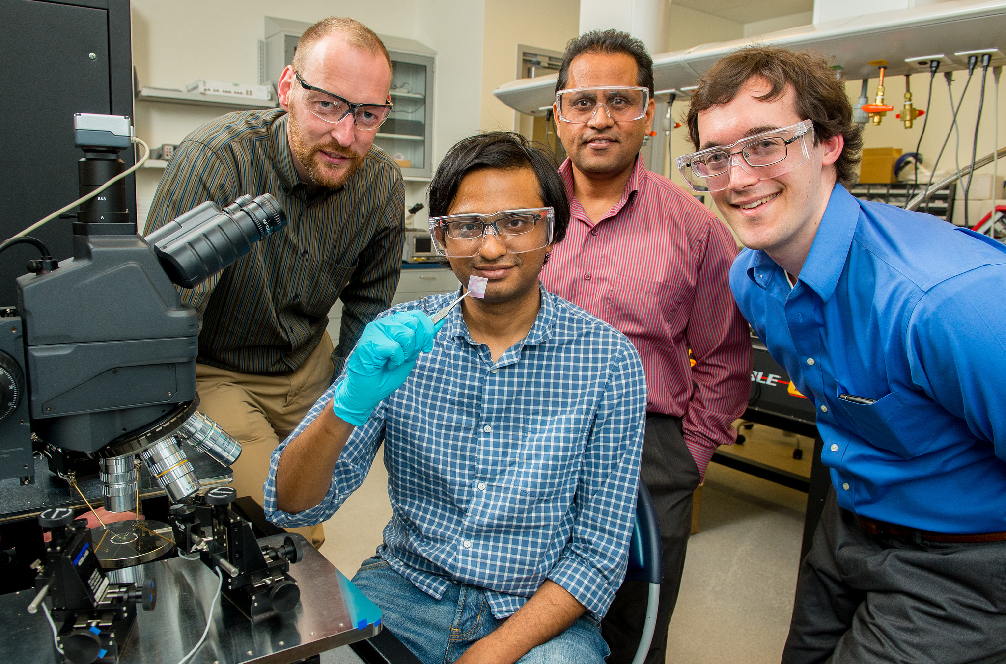 Andreas Roelofs, Anirudha Sumant, and Richard Gulotty; in foreground, Saptarshi Das, scientists from Argonne who created the world's thinnest flexible, transparent thin-film transistor, which could one day be useful in making a truly flexible display screen for TVs or phones.