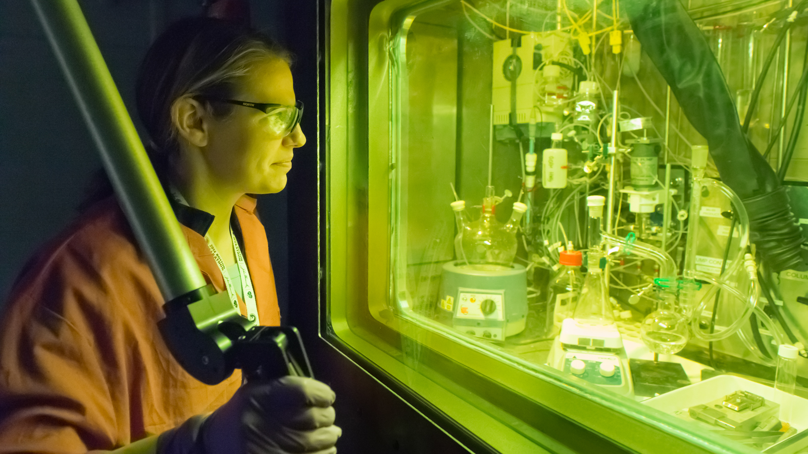 Argonne chemist Amanda Youker uses a remote manipulator arm to process and purify radioisotopes in a radiation cell.