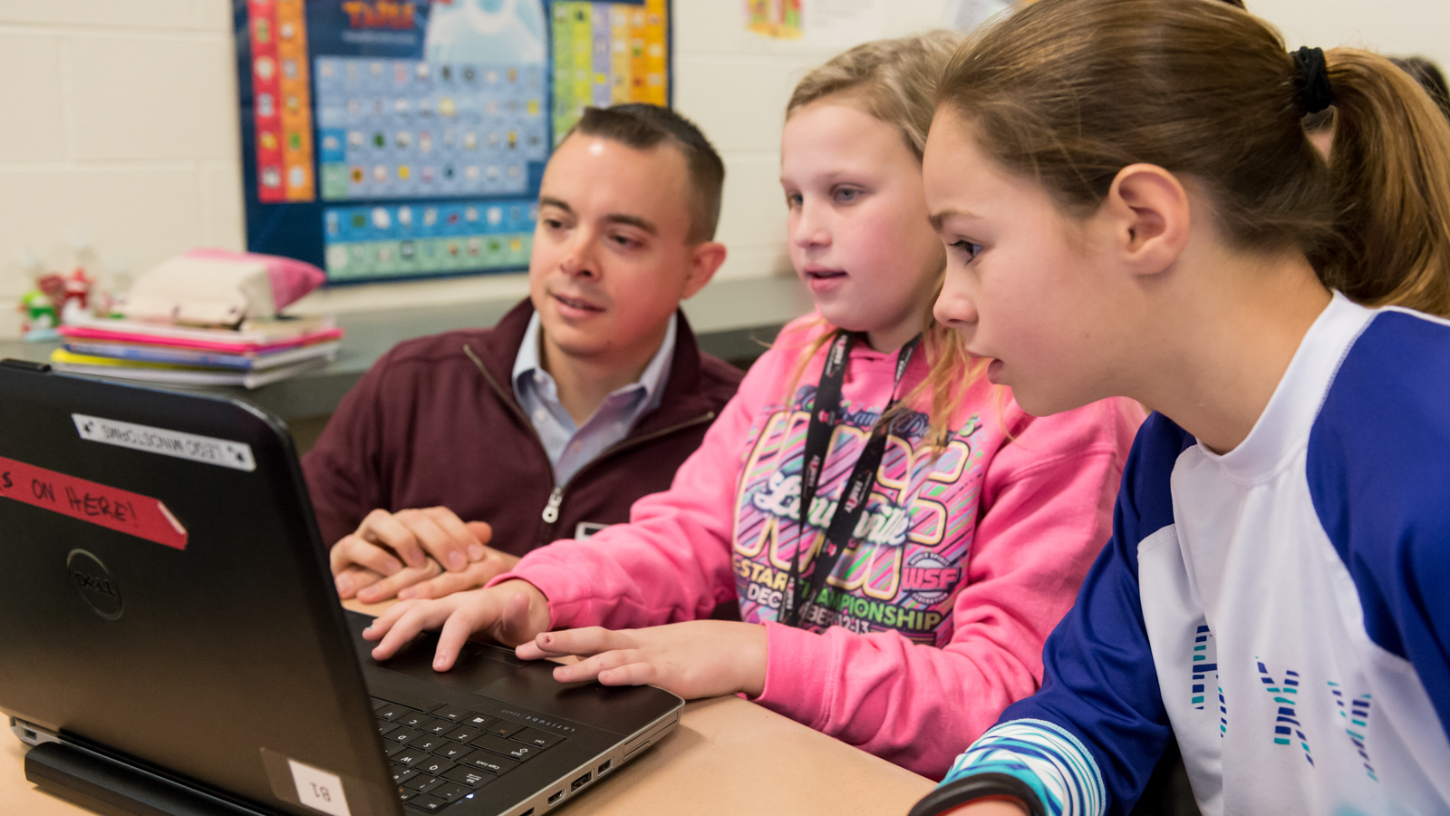 Argonne scientist Christopher Peters works with a group of young coders at Heritage Grove Middle School.