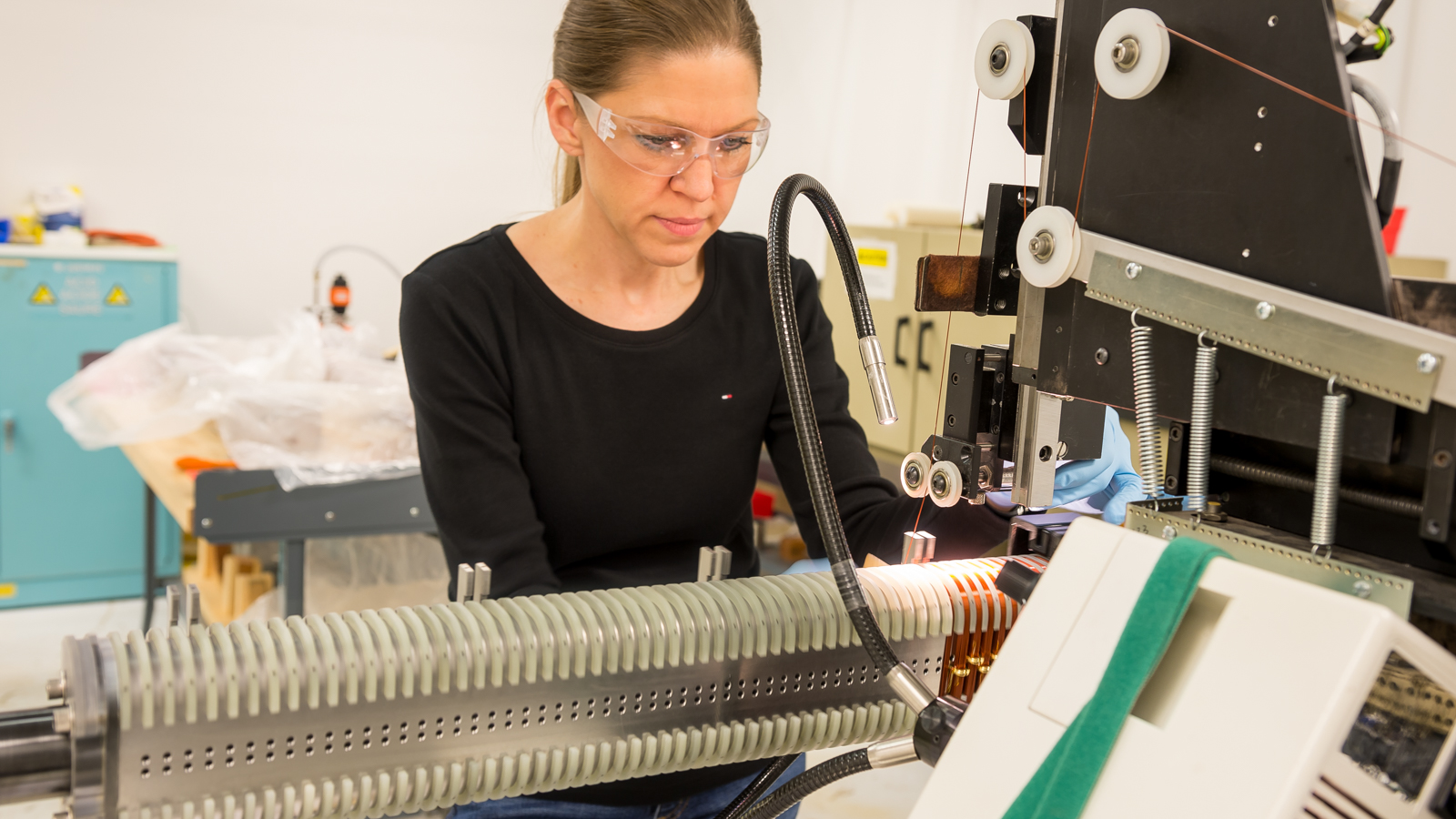 Technician Susie Bettenhausen controls the winding of the undulator magnet.