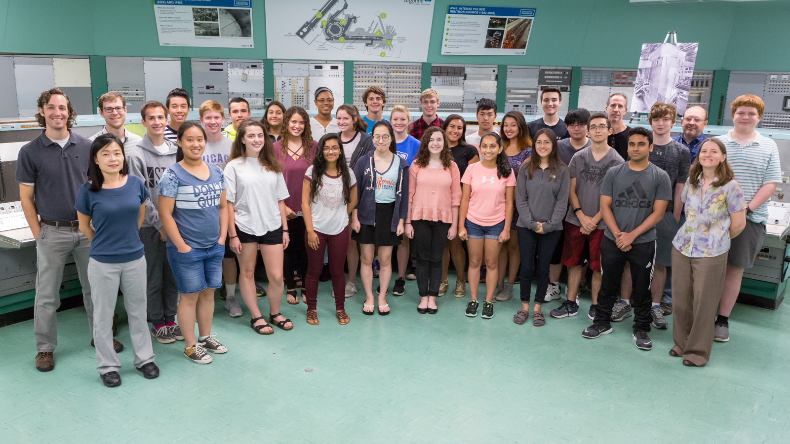 Students break for a group photo with teachers and organizers during this summer's coding camp in Argonne's historic 1960's control room.