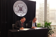 From left to right: Mark Keenum, President, Mississippi State University, and Peter Littlewood, director of Argonne National Laboratory, sign a memorandum of understanding for a collaboration to develop new technologies that address next-generation energy storage challenges.