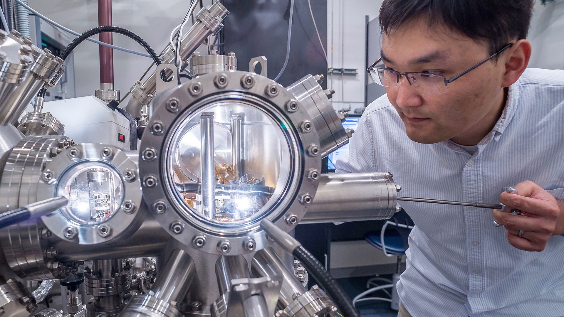 Postdoctoral researcher Rui Zhang at the Center for Nanoscale Materials uses an ultrahigh vacuum scanning tunneling microscope to image the surface structure of nanomaterials.