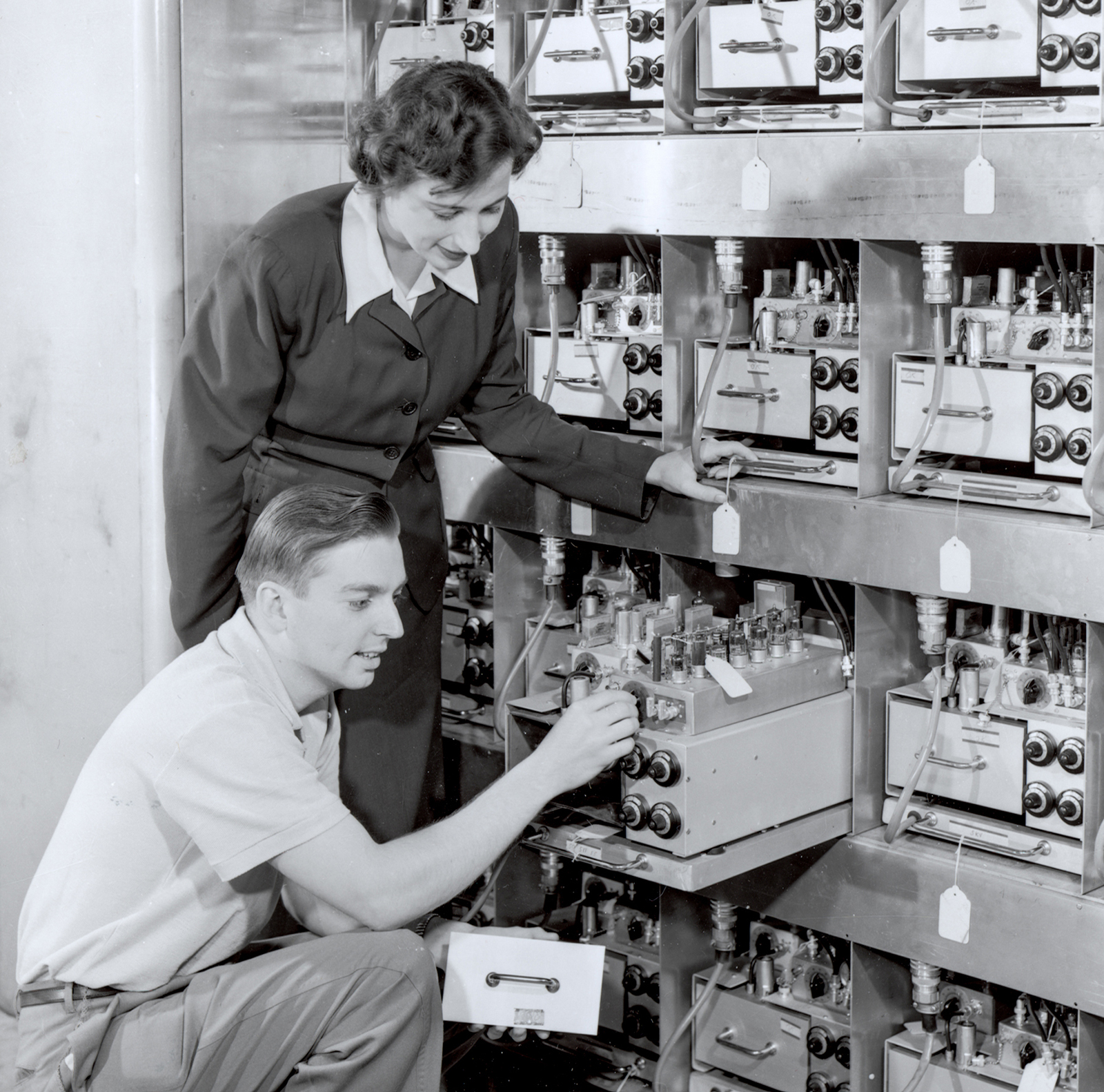 Margaret Butler helps assemble the ORACLE computer with Oak Ridge National Laboratory Engineer Rudolph Klein. In 1953, ORACLE was the world's fastest computer, multiplying 12-digit numbers in .0005 seconds. Designed at Argonne, it was constructed at Oak Ridge.