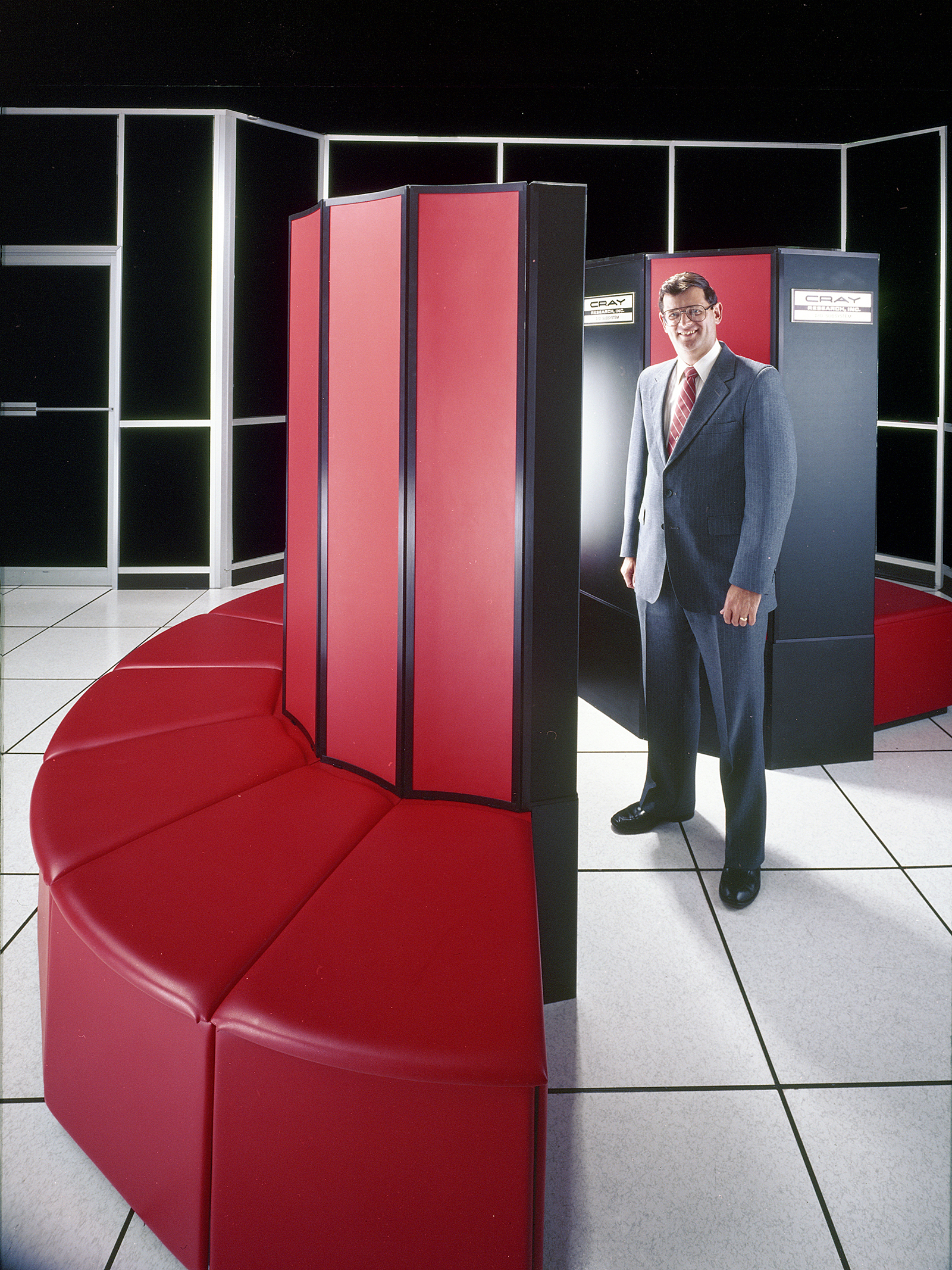 David P. Weber, Director of Argonne's Computing and Telecommunications Division from 1986-1994, with Argonne's Cray X-MP computer, a shared-memory parallel vector processor, in 1982. The Cray X-MP was the world's fastest computer between 1983-1985.