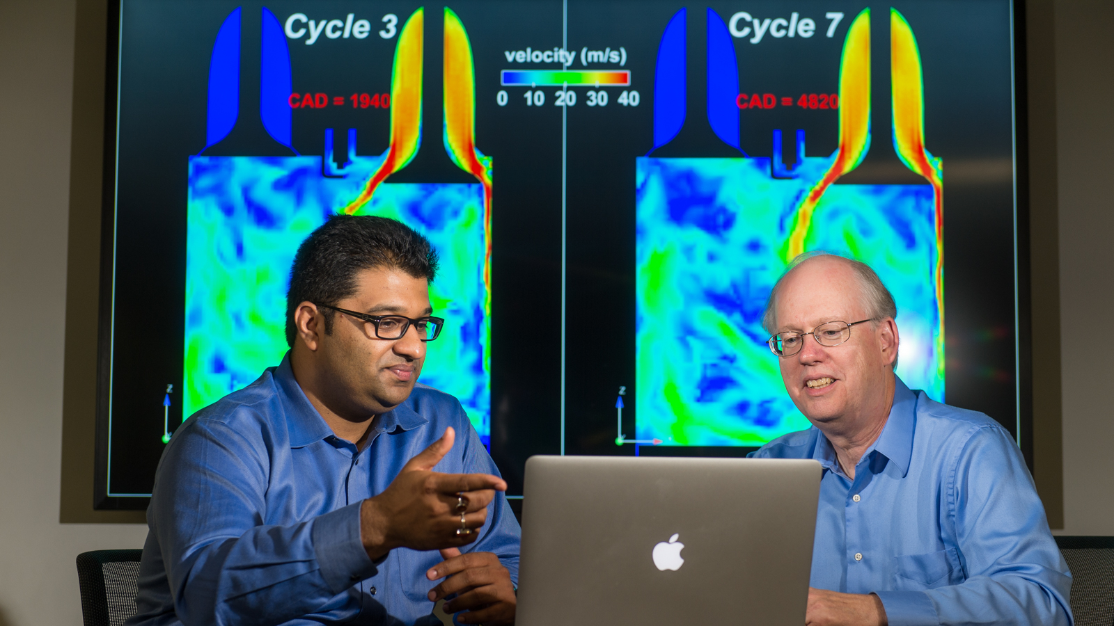 Argonne principal mechanical engineer Sibendu Som (left) and computational scientist Raymond Bair discuss combustion engine simulations conducted by the Virtual Engine Research Institute and Fuels Initiative (VERIFI). The initiative will be running massive simulations on Argonne's Mira supercomputer to gain further insight into the inner workings of combustion engines.