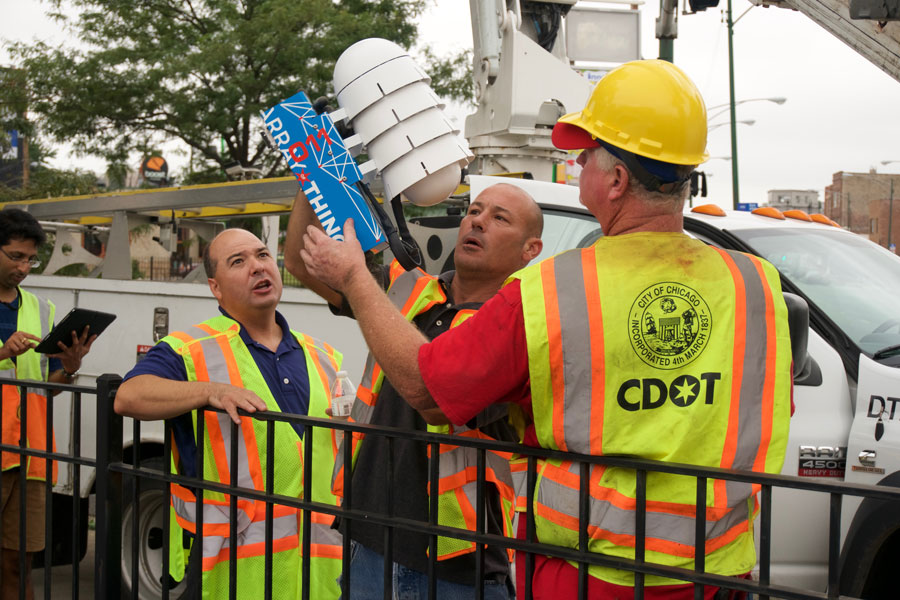 Chicago Department of Transportation workers install the first public Array of Things node at the intersection of Damen and Archer Avenues in Chicago.
