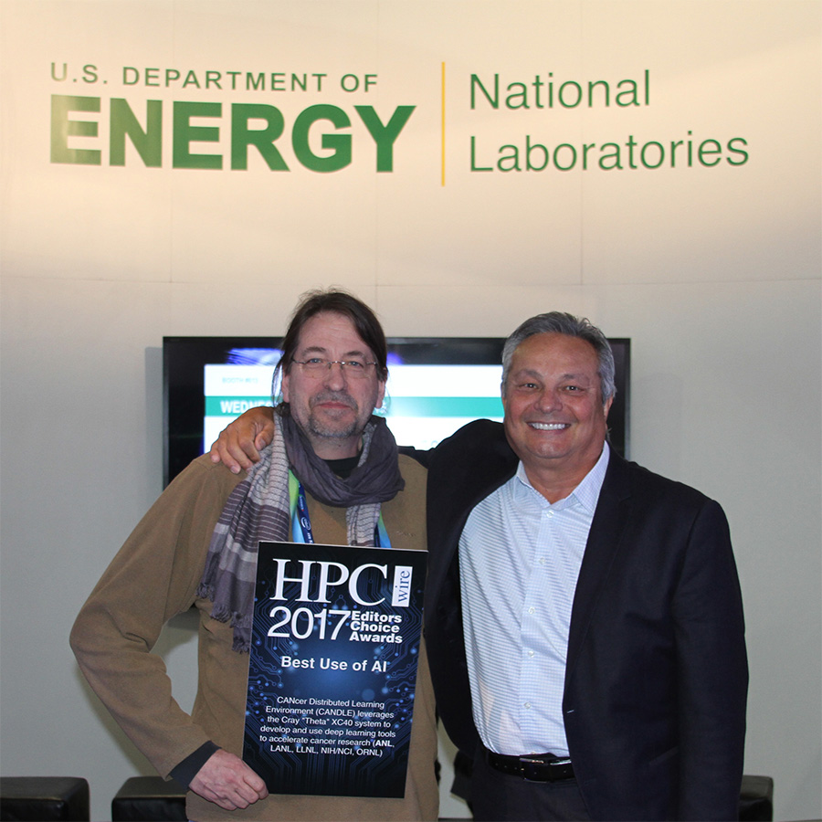 Rick Stevens, Argonne associate laboratory director and principal investigator of the CANDLE project accepts the award from HPCwire CEO Tom Tabor.