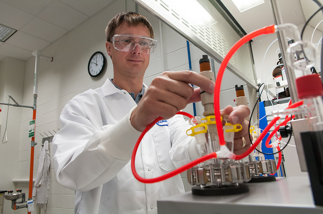 In the Materials Engineering Research Facility's process research and development lab, Argonne chemist Trevor Dzwiniel sets up a reaction calorimeter, which precisely measures how much heat a chemical reaction generates. This vital information is used to assess the scalability and safety of a reaction or process.