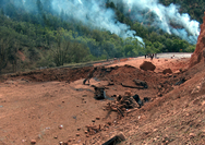Researchers are using Argonne's supercomputer Mira to model how explosives detonate, hoping to understand and prevent disasters like this 2005 event, when a semi-truck hauling 35,000 pounds of explosives through the Spanish Fork Canyon in Utah crashed and caught fire, causing a dramatic explosion that left a 30- by-70-foot crater in the highway. Photo courtesy Utah Department of Transportation