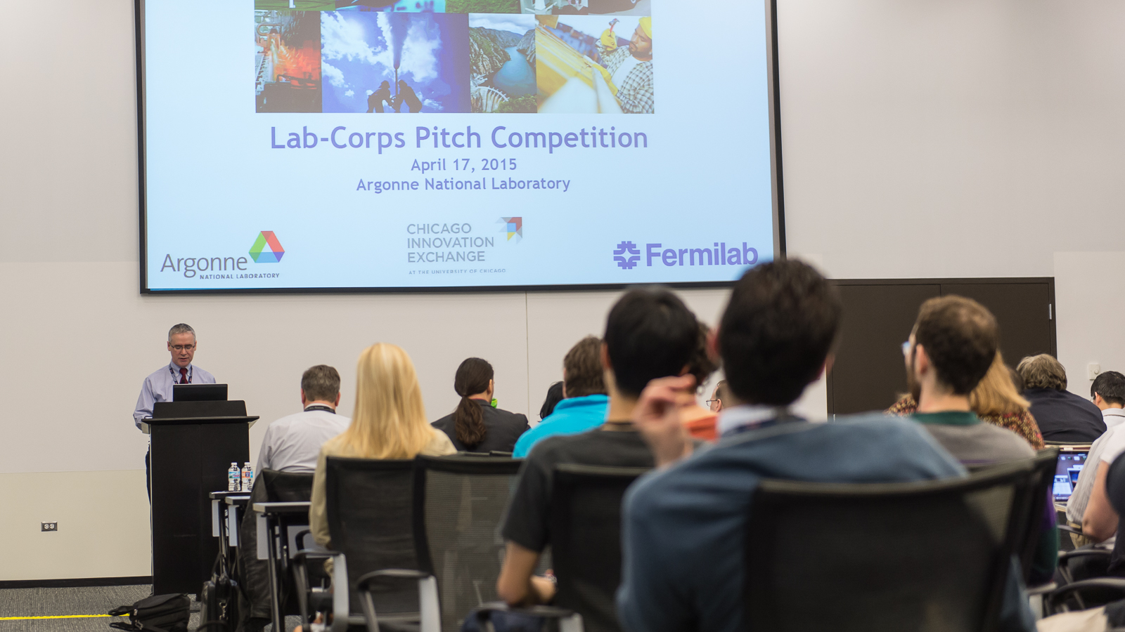 Seated participants listening to lecturer and viewing presentation at Lab-Corps, a U.S. Department of Energy program.