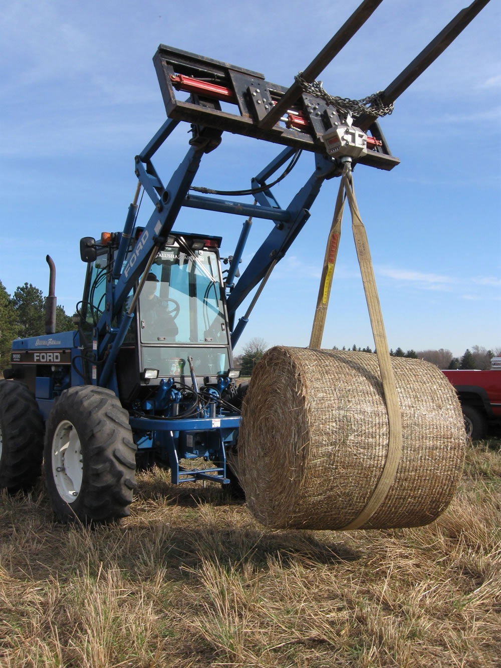 A bale of switchgrass is weighed after harvesting.