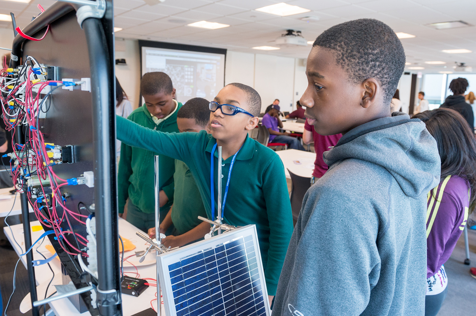 """At """"Charging up the Classroom,"""" students check how much power they have produced after using wind turbines and solar panels to generate electricity. All photos by Mark Lopez/Argonne National Laboratory."""