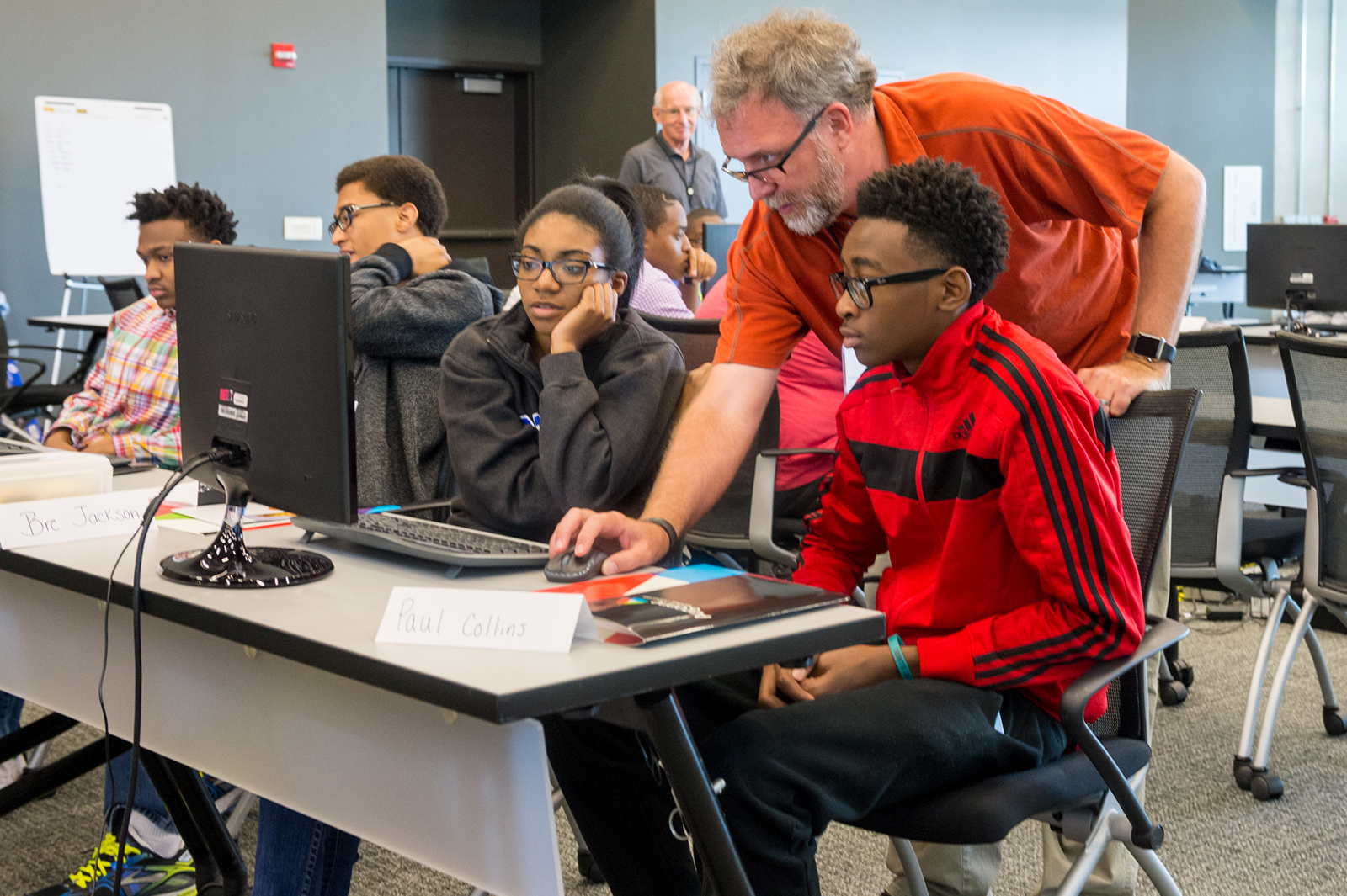 Mike Papka, director of the Argonne Leadership Computing Facility, works with high school students at coding camp. Students learned the Python programming language, among other problem-solving skills related to computer science.