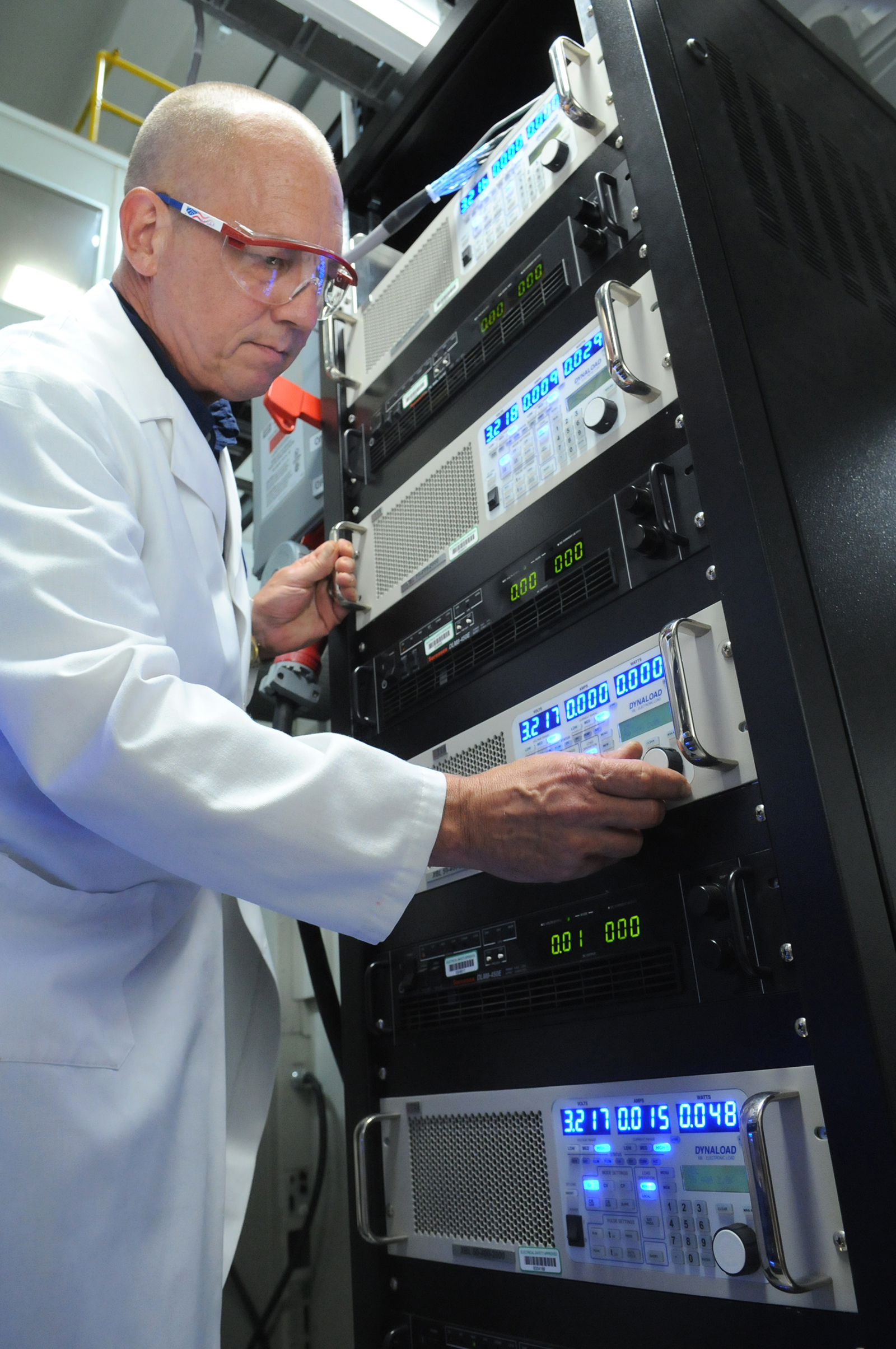 Researcher John Basco prepares for battery testing at Argonne's Elecrochemical Analysis and Diagnostics Laboratory.