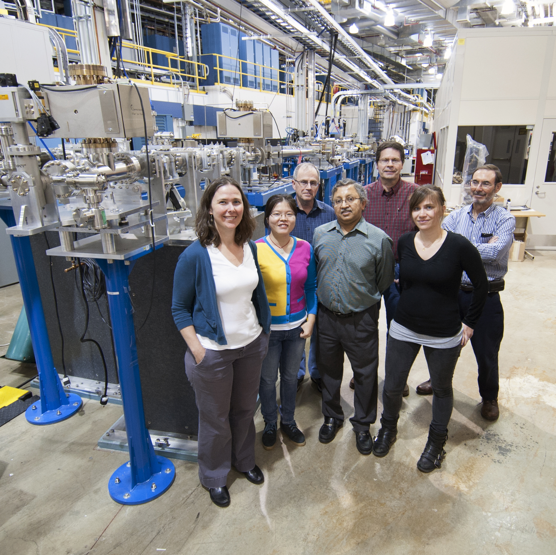 Members of the Intermediate Energy X-ray collaborative development team standing in front of the beamline. Left to right: Jessica McChesney, Yizhi Fang, Tim Roberts, Mohan Ramanathan, Mike Fisher, Fanny Rodolakis, and Ruben Reininger.