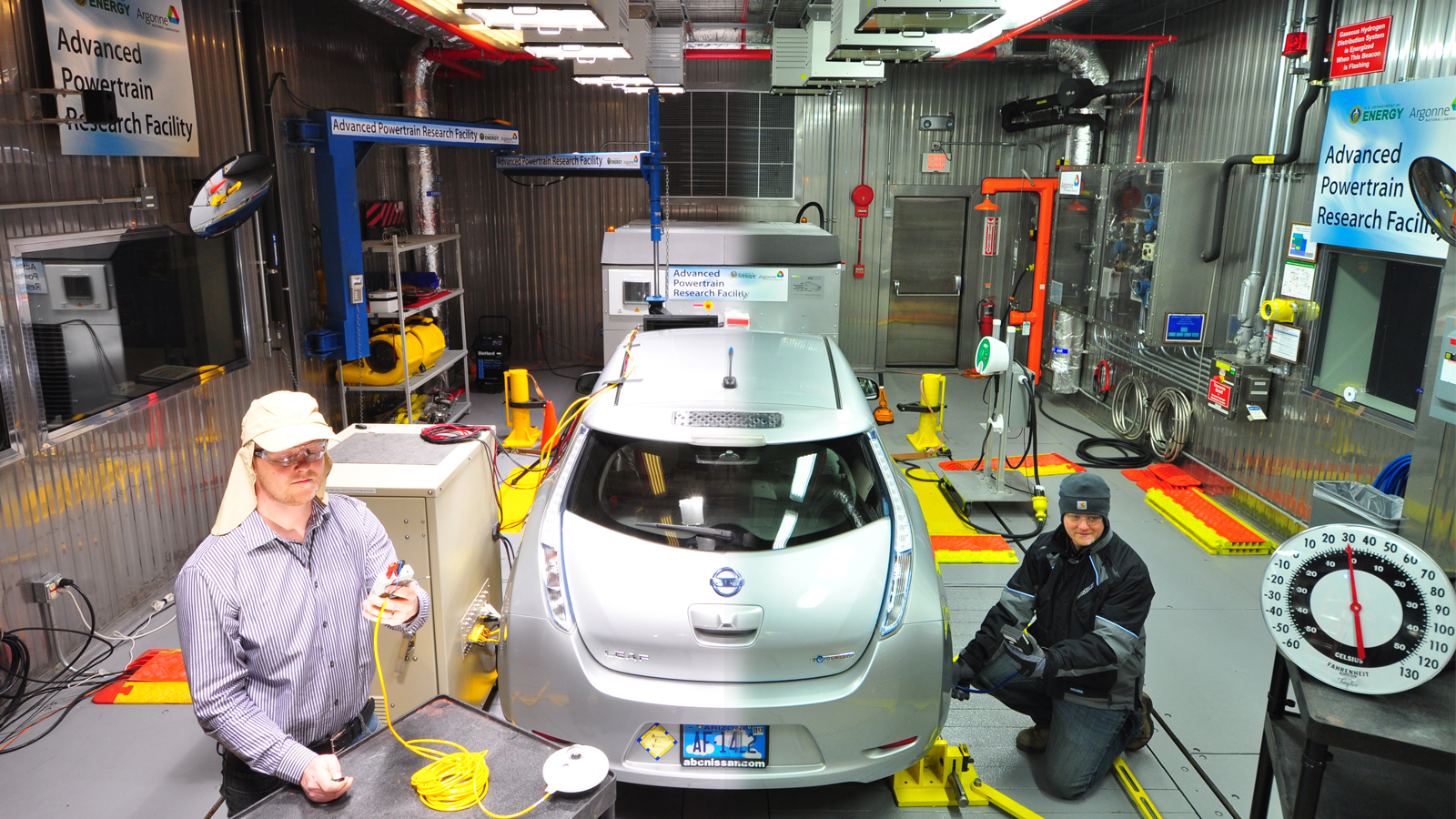 In this split screen image, Argonne engineer Henning Lohse-Busch evaluates an electric vehicle under extreme hot (left) and cold conditions (right). The Advanced Powertrain Research Facility's Environmental Test Cell is equipped to evaluate vehicles and their components at a temperature range of 20°F to 95°F.