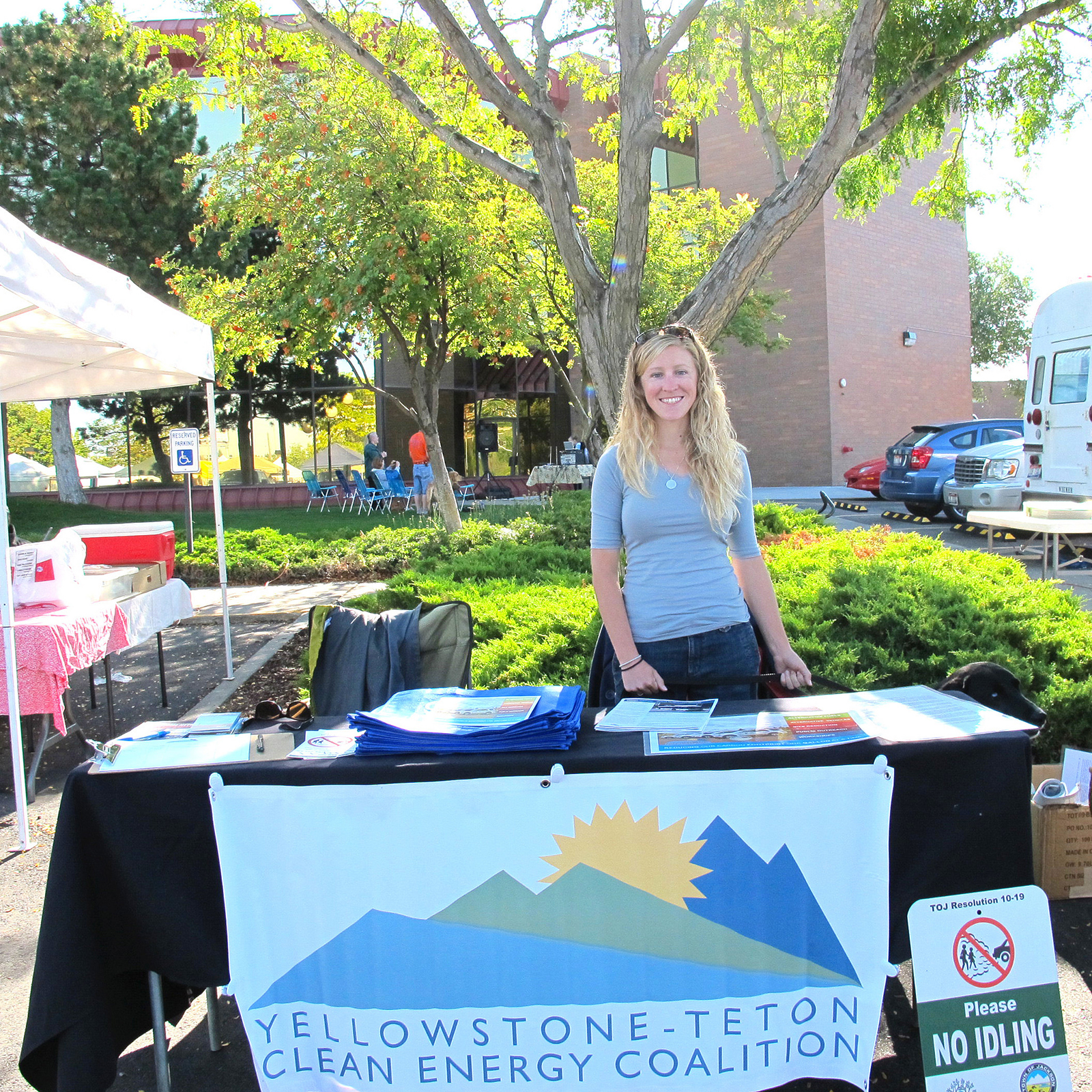 Alicia Cox, past intern for the Yellowstone-Teton Coalition, staffs a booth at an outreach event.