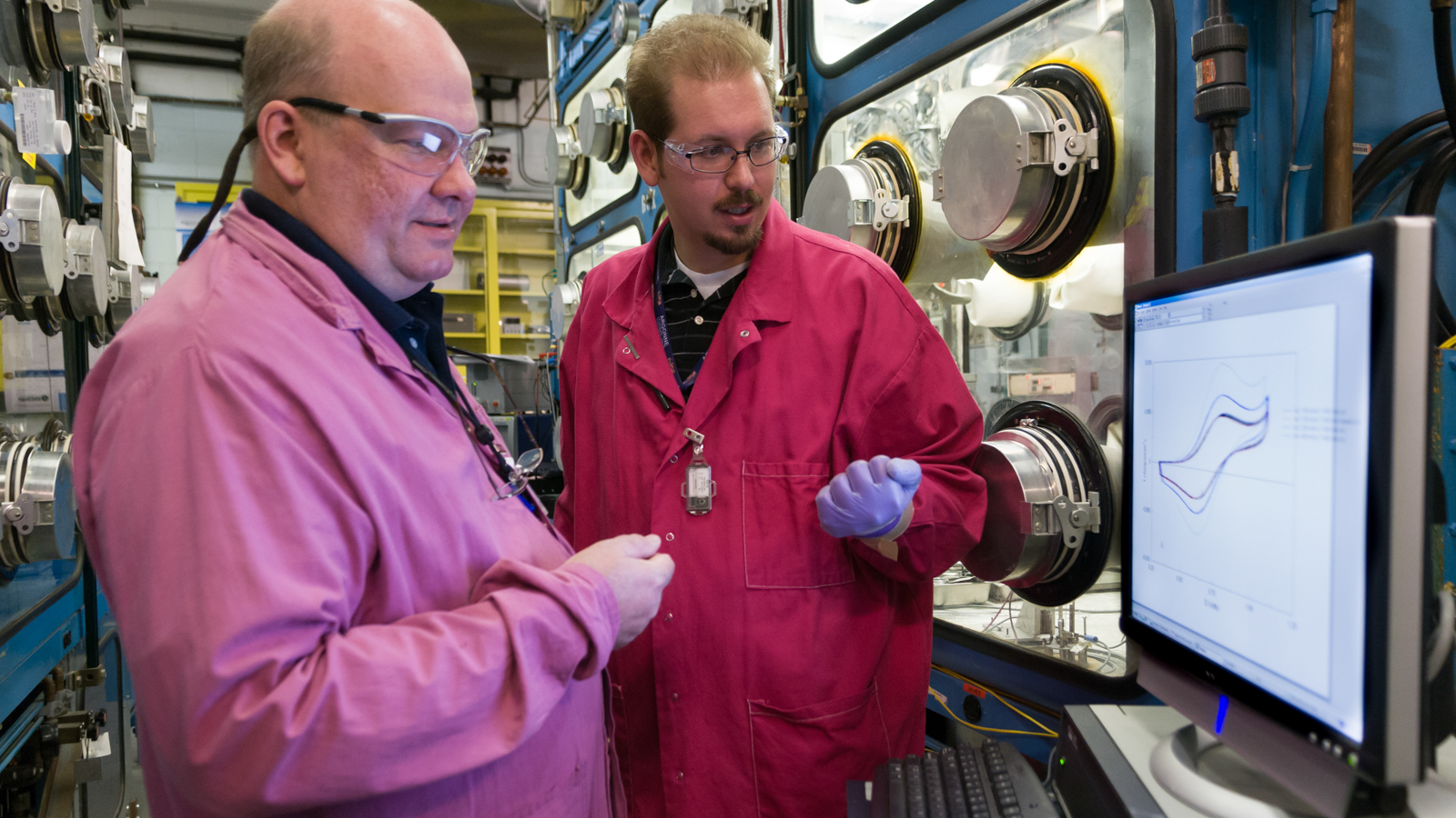 Argonne researchers Jim Willit (left) and Nick Smith review data from in-situ process monitoring for pyrochemical systems.
