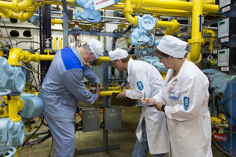 Monitors Julie Bremser, Jose March-Leuba, and Russian counterpart Aleksander Tikhonov check the tamper-indicating devices on the highly enriched uranium hexafluoride gas piping at the Ural Electrochemical Integrated Plant in Russia.