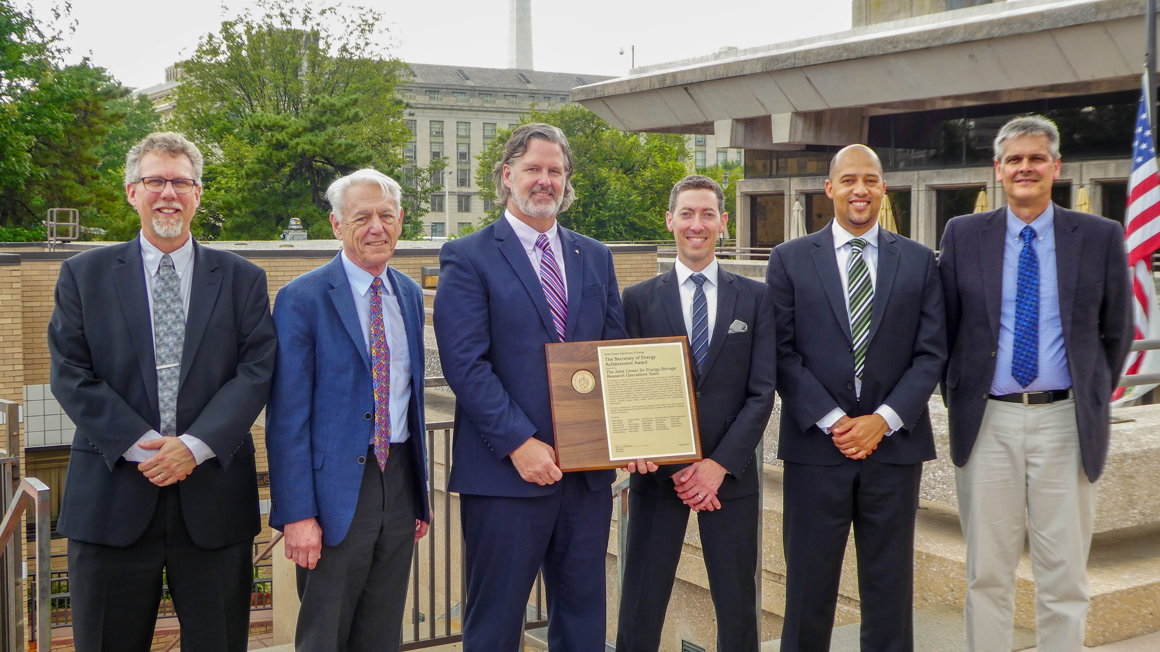 Karl Mueller, George Crabtree, Devin Hodge, Brian Ingram, Fikile Brushett and Kevin Zavadil accepted the Secretary of Energy's Achievement Award on behalf of the 29 individuals who received the award.