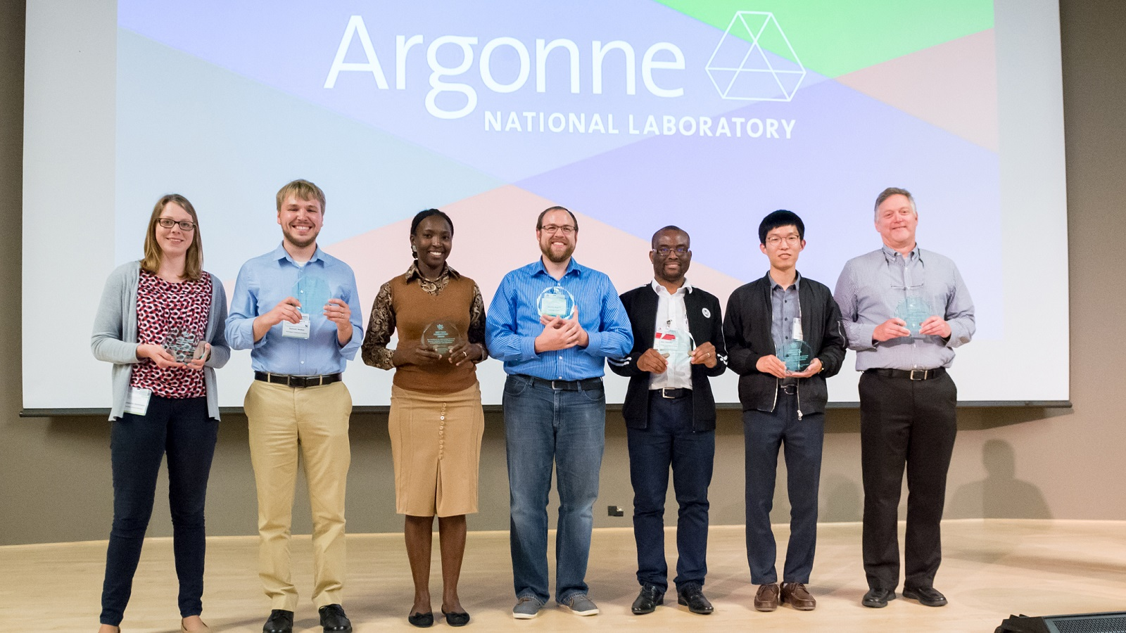 These seven students received awards for the best presentations at the end of Argonne's two-week Modeling, Experimentation and Validation summer school. (Image by Argonne National Laboratory.)