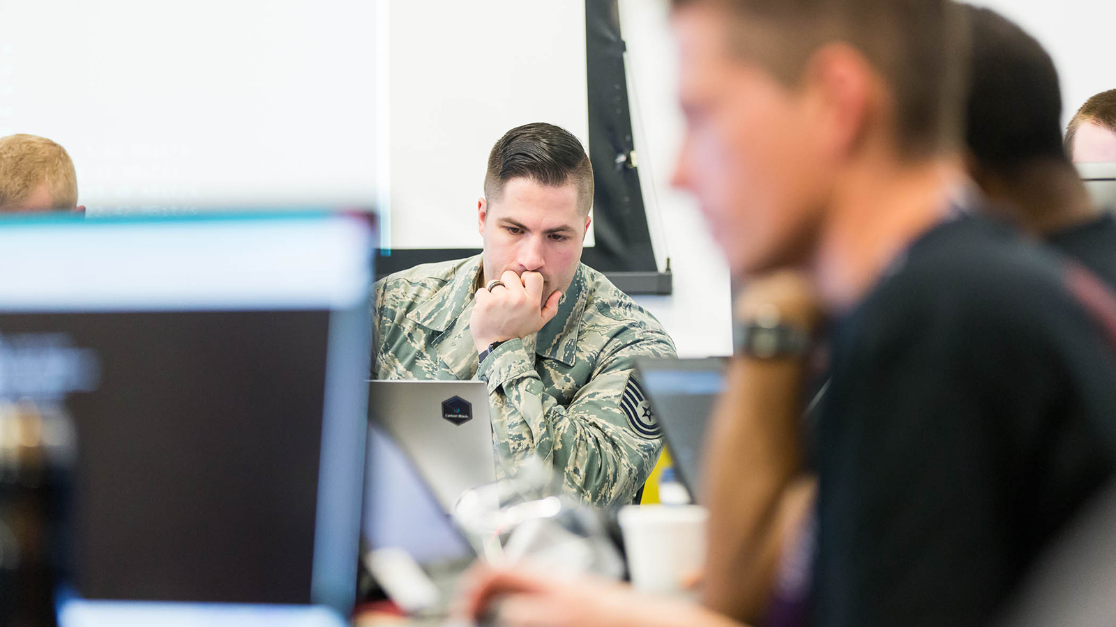 A member of the Red Team of faux cyber attackers plots his next move during the prior CyberForce Competition. (Image by Argonne National Laboratory.)