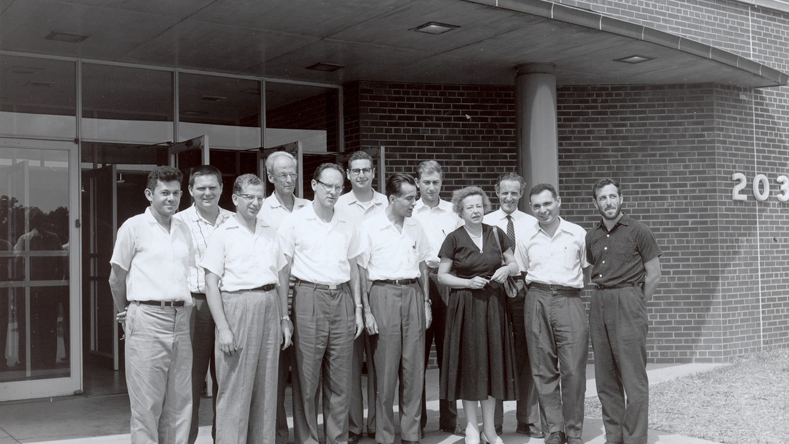 Here Maria Goeppert Mayer (fourth from right) poses with her colleagues in front of Argonne's Physics building. (Image by Argonne National Laboratory.)