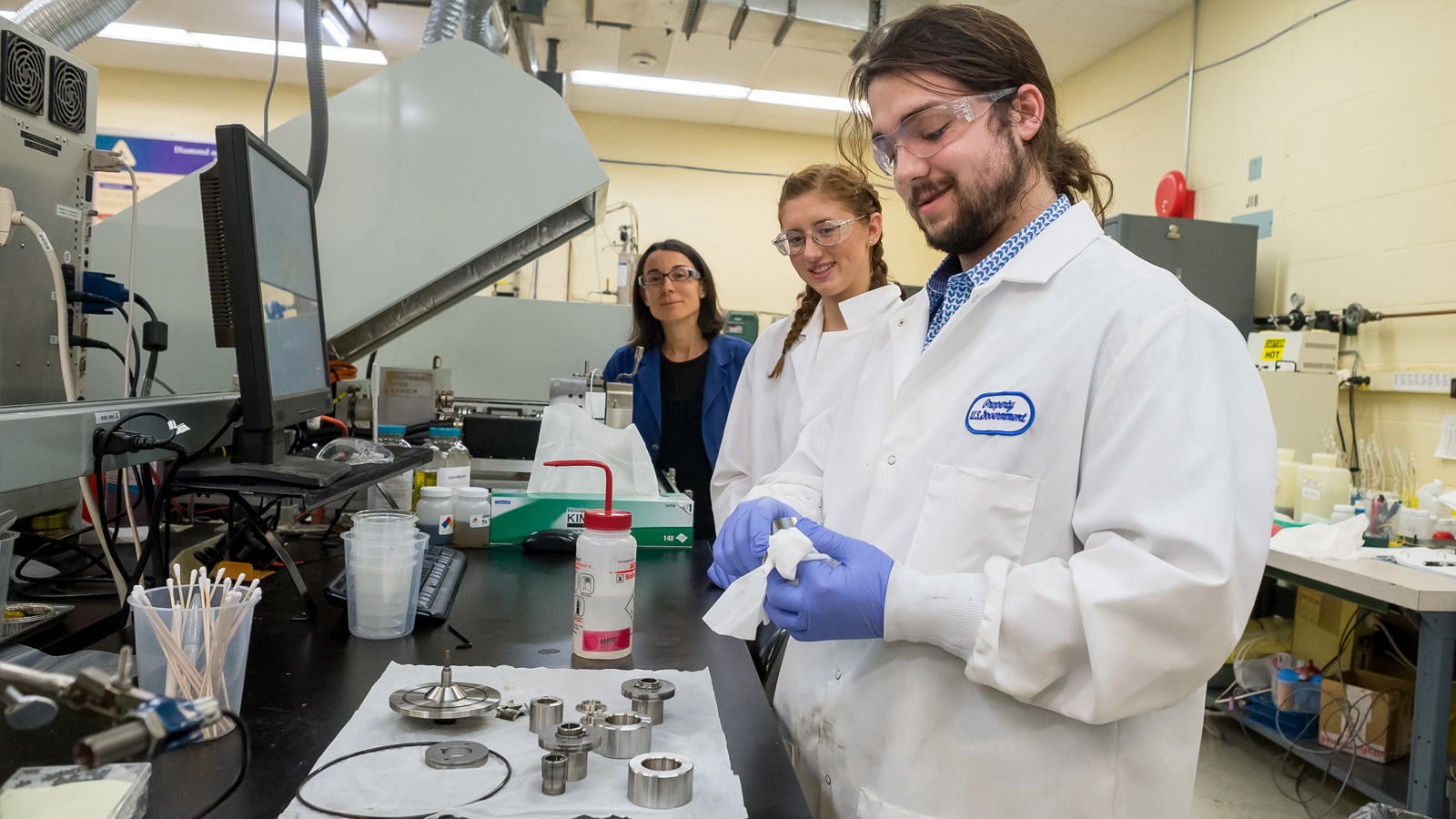Maria De La Cinta Lorenzo Martin, an Argonne scientist, oversees Northwestern University summer interns Ally O'Donnell, a senior in mechanical engineering, and Jacob Hechter, a junior in materials science, as they prepare wind turbine components for testing. (Image by Argonne National Laboratory.)