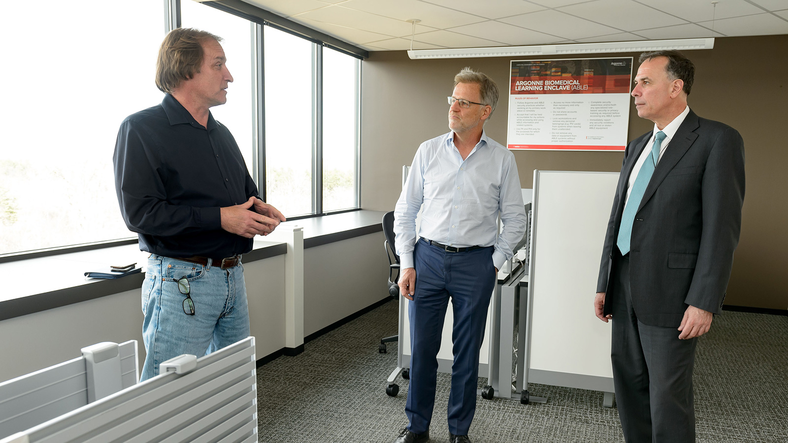 Dimitri Kusnezov (right) visits the new Argonne Biomedical Learning Enclave (ABLE) with Tom Brettin (left) and Ian Foster (middle).