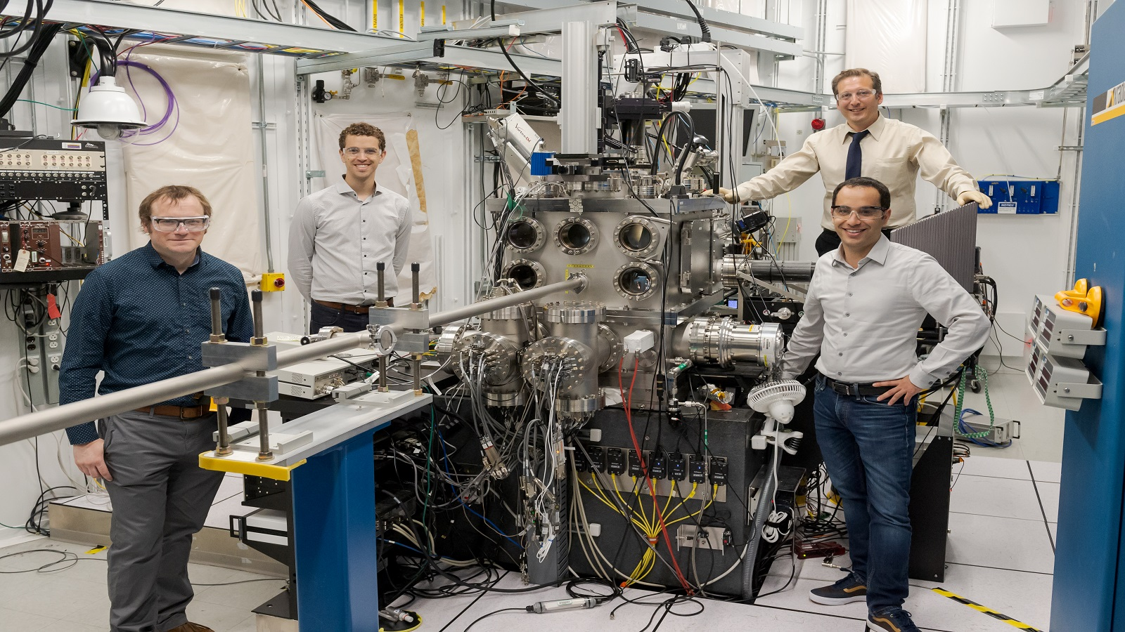 Argonne and University of Chicago scientists Joseph Heremans, Samuel Whiteley, Martin Holt, and Gary Wolfowicz stand by Argonne's Hard X-ray Nanoprobe beamline, which was used for a new technique called stroboscopic Bragg diffraction microscopy to image sound waves in a crystal.