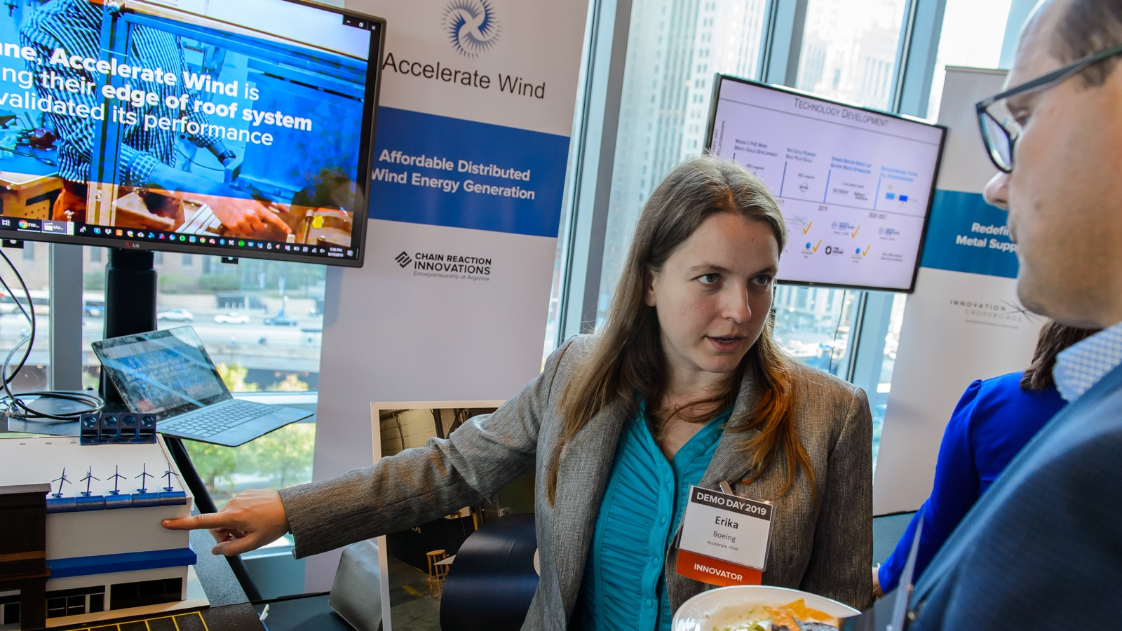 Erika Boeing, CEO of Accelerate Wind, shows her distributed wind rooftop-based generation platform at Demo Day. (Image by Argonne National Laboratory.)