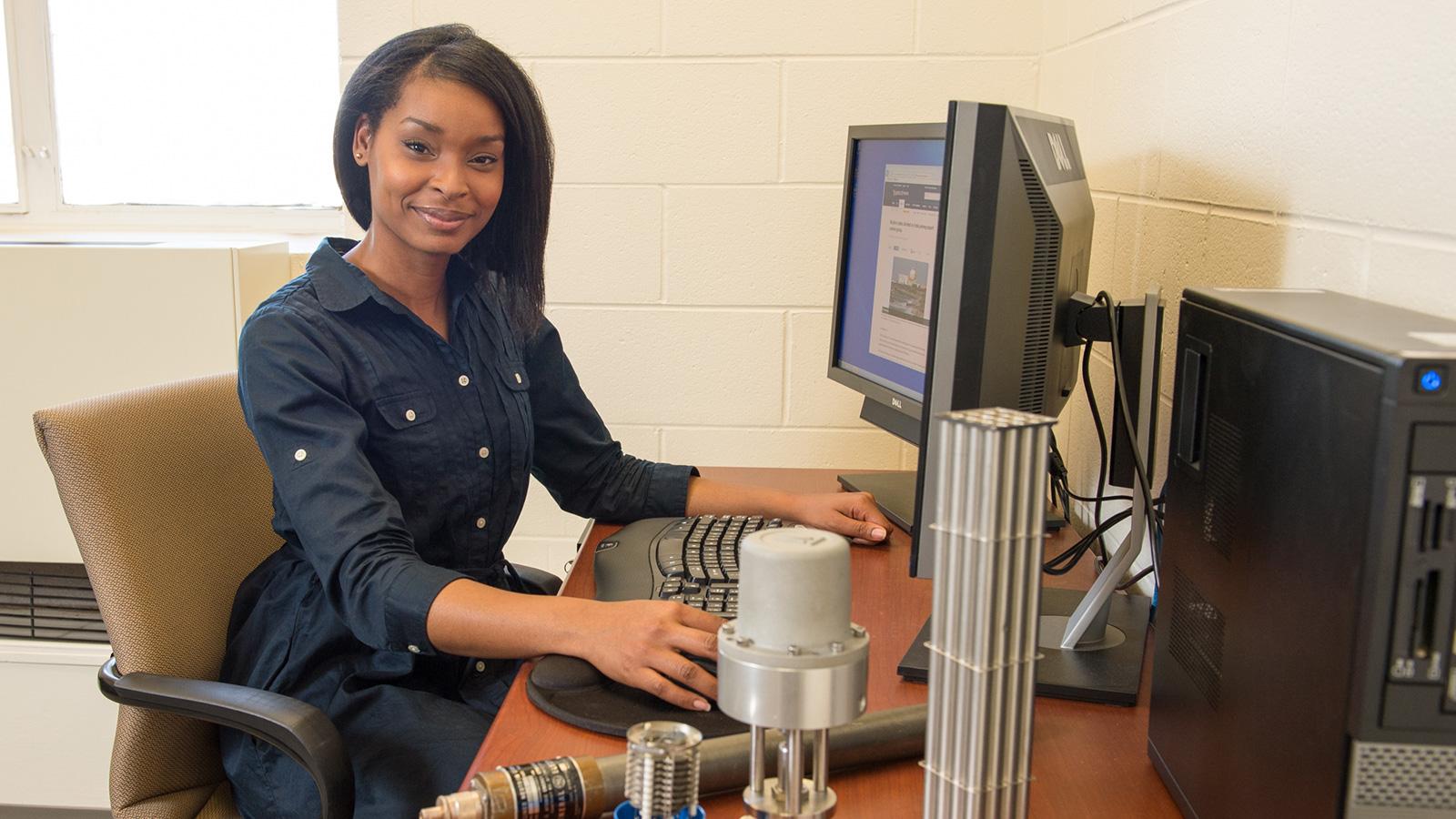 J'Tia Hart at desk