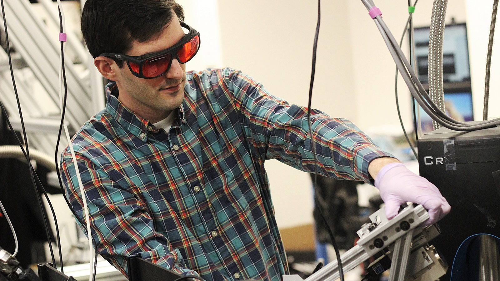 PhD student Paul Jerger adjusts the mount that lets researchers rotate and position their magnet.
