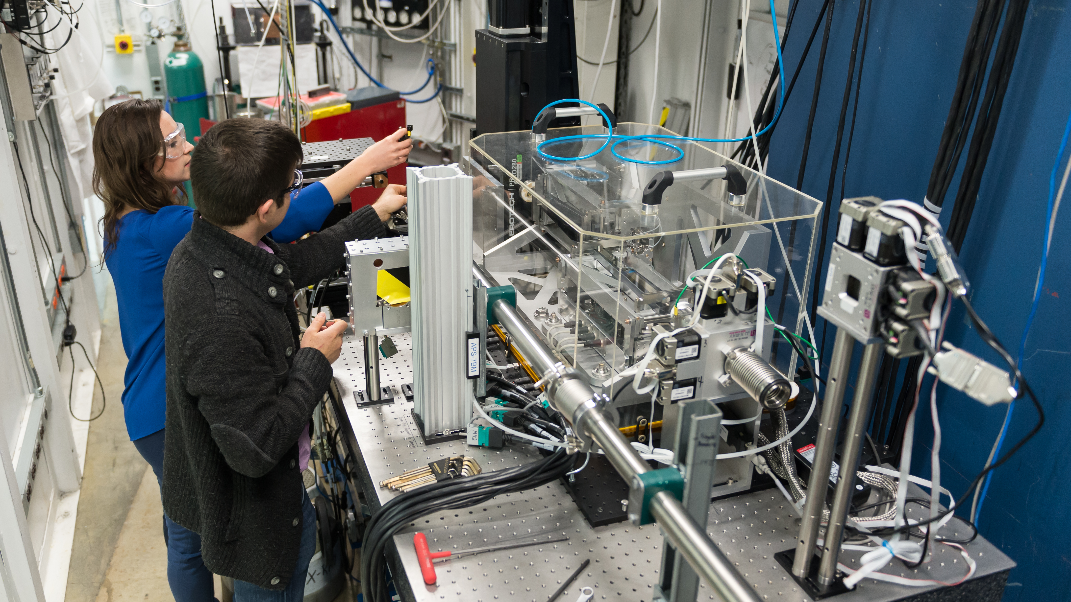 Brandon Sforzo and a former colleague prepare an experiment to investigate fuel injector design at the Advanced Photon Source.