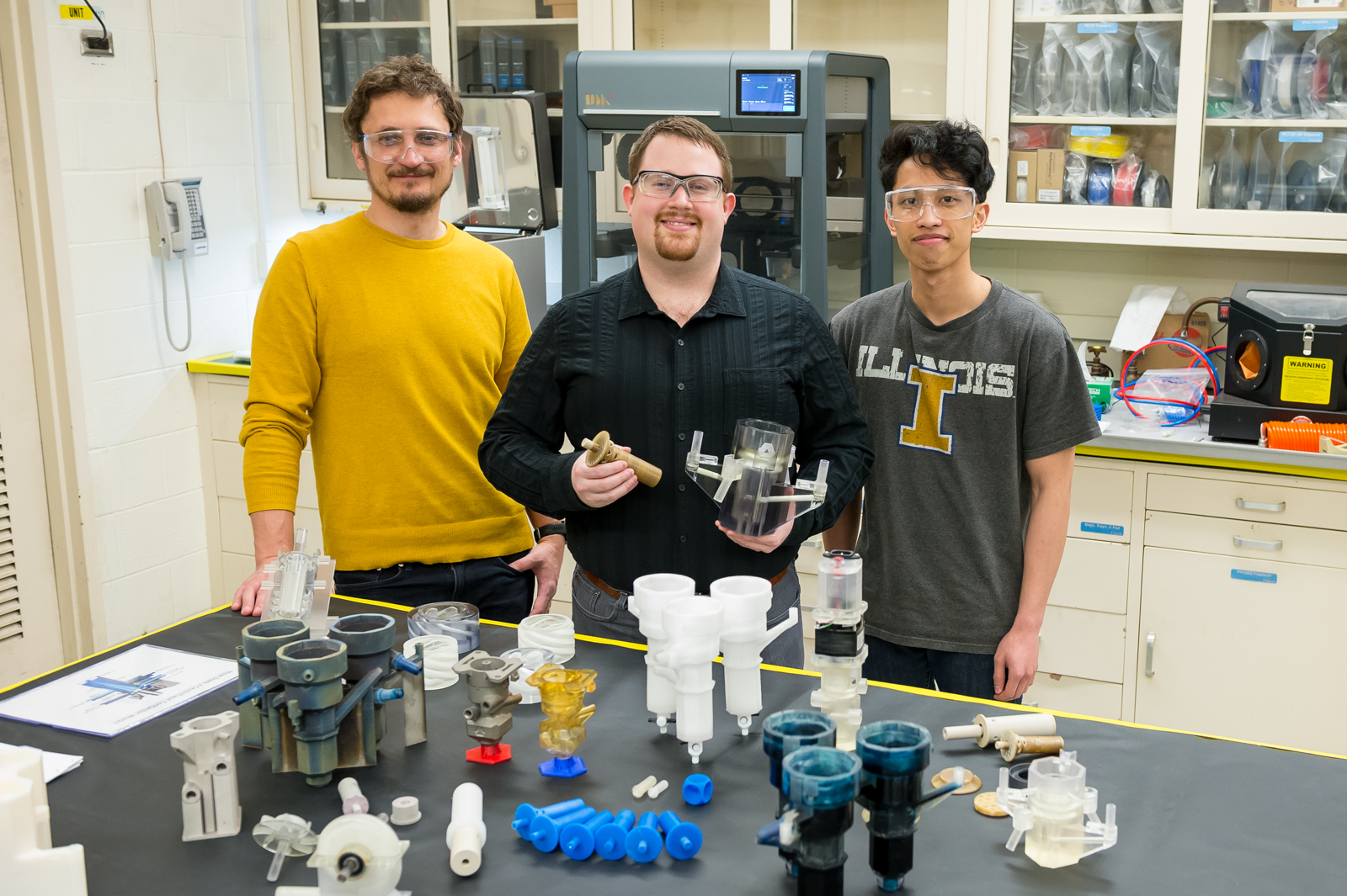 The laboratory's new 3D printing methods makes make its recycling method – pioneered in 2015 by Mo-99 program manager Peter Tkac (left) and others – faster, more reliable, and more cost effective. Also shown: Peter Kozak (center) and Brian Saboriendo. Not shown: Alex Brown. (Image by Argonne National Laboratory.)