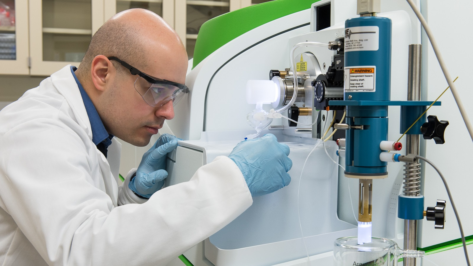 Pietro Lopez operates the setup used to perform the in situ dissolution measurements of trace levels of iron interacting dynamically with the electrode surface. (Image by Mark Lopez, Argonne National Laboratory.)