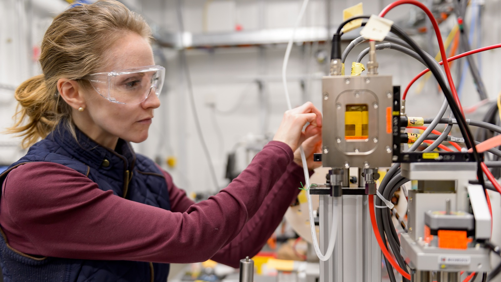 Ashley Spear of the University of Utah adjusts a beam-defining slit on the new high-throughput instrument installed at the 6-ID-D end-station of the Advanced Photon Source.