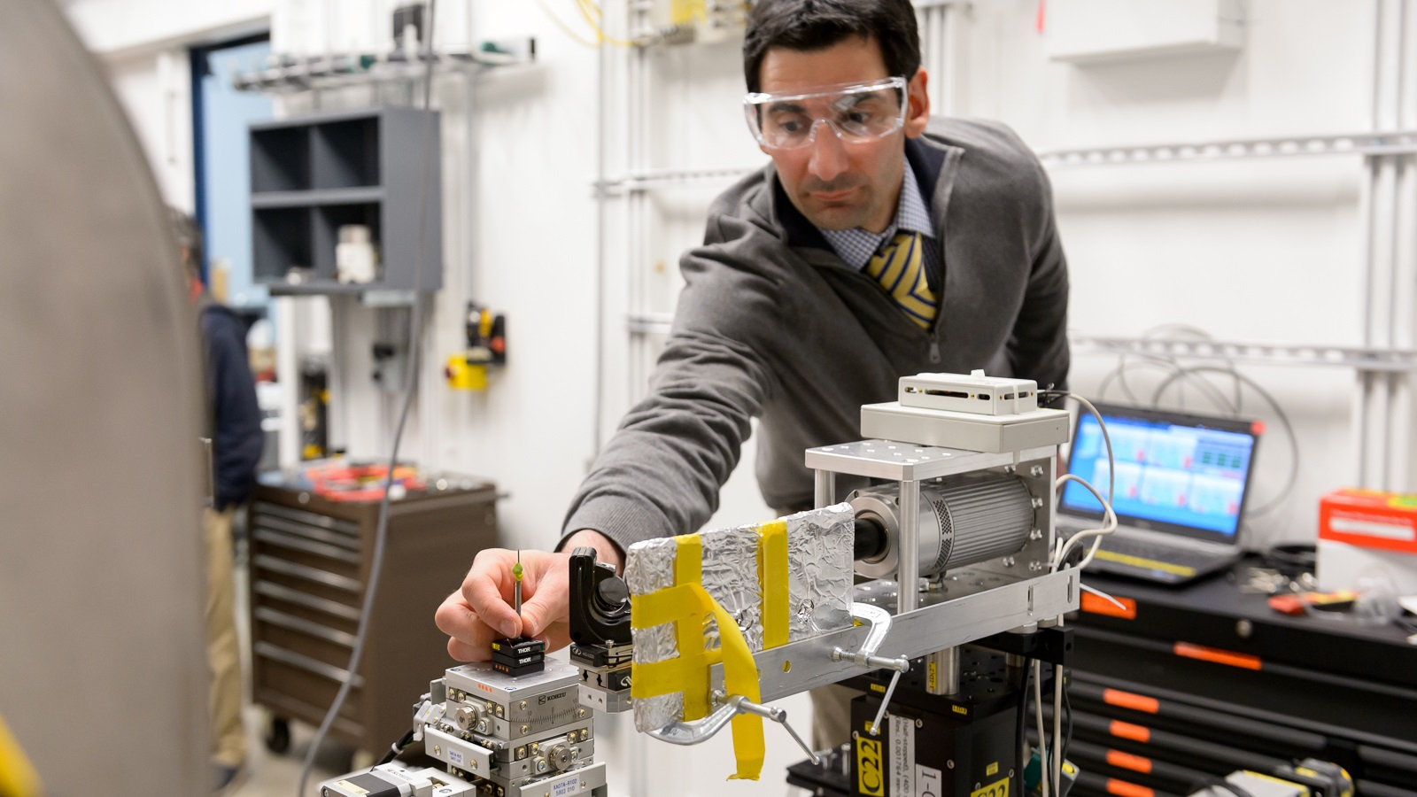 Michael Sangid of Purdue University installs a sample on the new high-throughput instrument installed at the 6-ID-D end-station of the Advanced Photon Source. Purdue joined four other institutions in making this new instrument a reality.