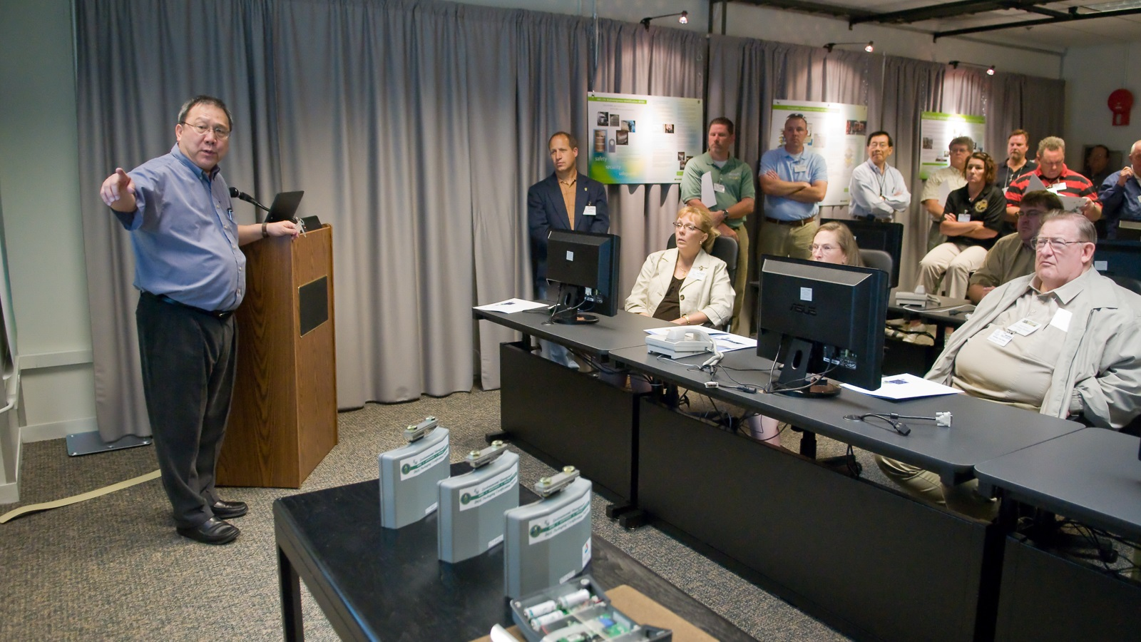 Argonne's Yung Liu (left) explains the essentials of nuclear packaging and his ARG-US remote monitoring systems technology to students. (Image by Argonne National Laboratory.)