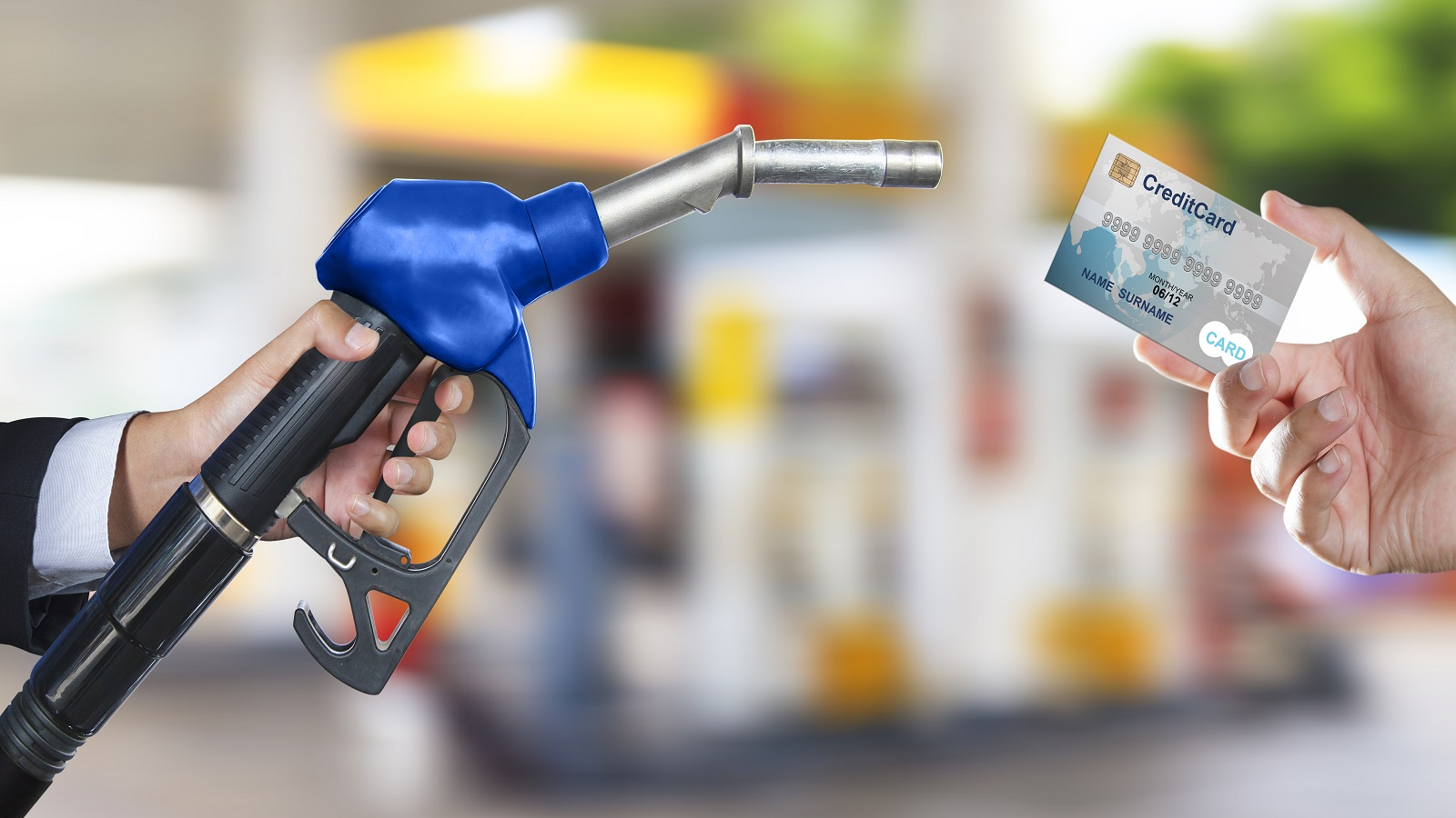 Photo of gas pump handle and credit card. (Image by Shutterstock/Naypong Studio.)