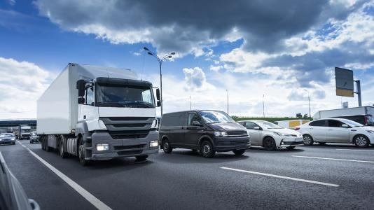 Photo of truck and cars. (Image by Shutterstock/MakDill.)