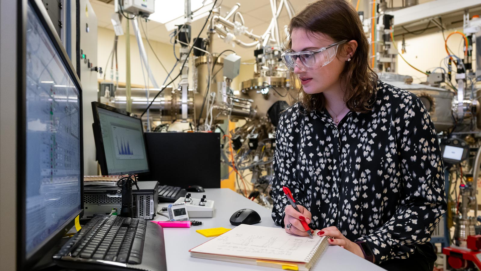 Katie Sautter is a postdoctoral researcher in Supratik Guha's lab at Argonne National Laboratory. She builds materials for quantum devices using a molecular beam epitaxy machine. (Image by Argonne National Laboratory.)