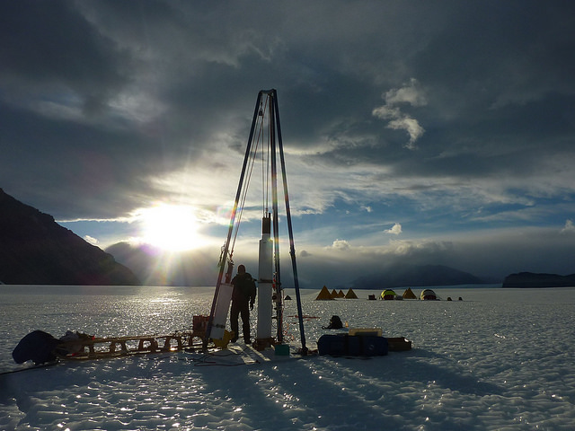 Ice core driller Tanner Kuhl works with the blue ice drill on Taylor Glacier in Antarctica.