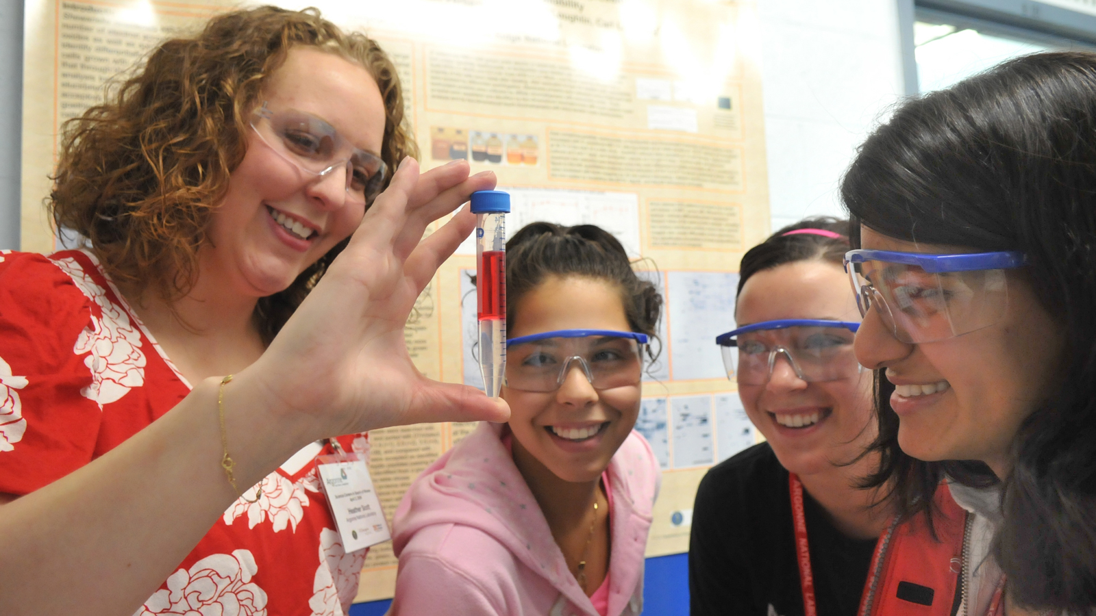 From left: Teacher Heather Scott and students Stephanie Lamas, Dana Bielinski and Smriti Marwaha examine a test tube at Science Careers in Search of Women.