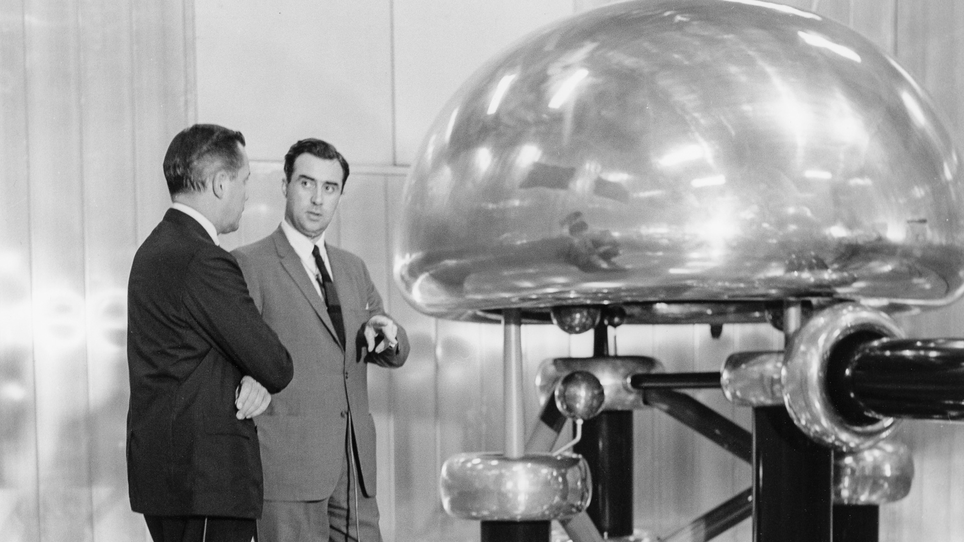 Albert Crewe (right), Argonne director from 1961 to 1967, explains the ZGS's Cockroft-Walton pre-accelerator.