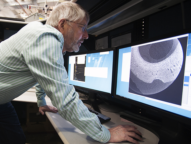 Prof. Stuart Stock (Northwestern University) studies an image of a shark spine sample, obtained using high-brightness X-rays at the X-ray Science Division beamline 2-BM research station at the Advanced Photon Source. (Image by Argonne National Laboratory.)