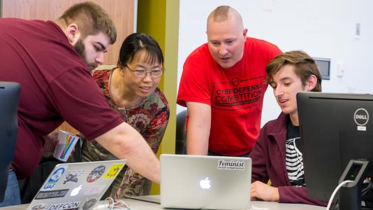 Members of the Red Team strategize new ways to attack the systems of teams at the first annual Argonne Collegiate Cyber Defense Competition