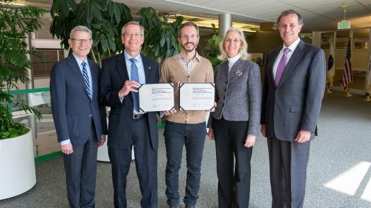 Chick Macal, Jonathan Ozik and Nick Collier (not shown) received the DOE Secretary's Appreciation Award for their advanced modeling research on how an Ebola outbreak might affect U.S. cities.